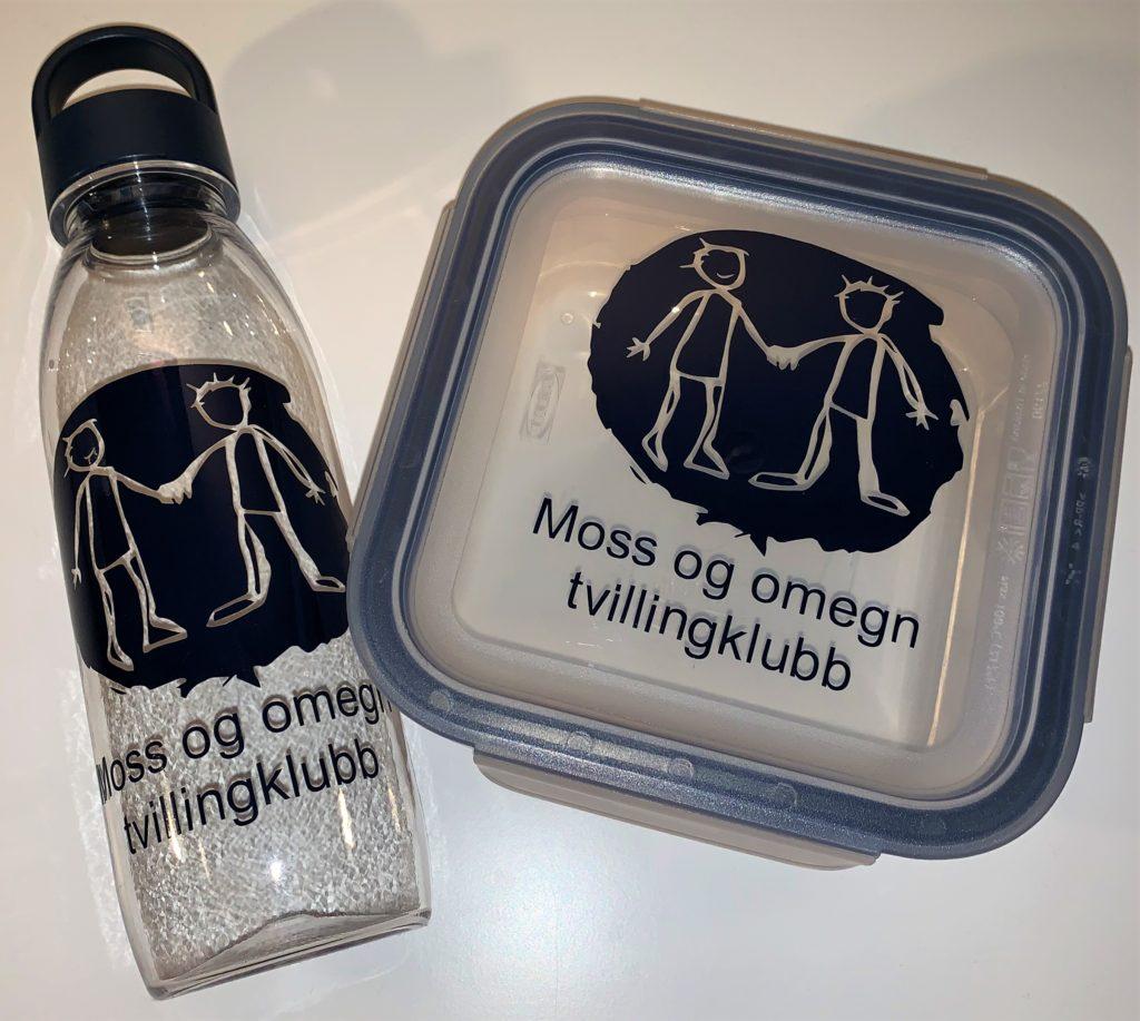 Flaske og matboks med klubbens logo
